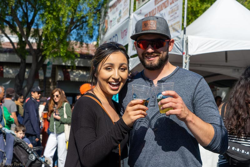 couple enjoying cold craft brews