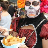 Costumed woman with fresh tamale