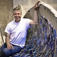 Artist Peter Hazel with wave bench